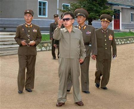 North Korean leader Kim Jong-il (C) visits a military unit at an undisclosed location in North Korea in this recent picture released by KCNA on August 16, 2008. REUTERS/KCNA