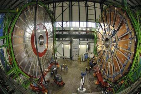 Overview of the first element (L) of the huge magnet of the CMS (Compact Muon Solenoid) experimental site at the European Organization for Nuclear Research CERN (Centre Europeen de Recherche Nucleaire) before its lowering on Thursday in the French village of Cessy near the Swiss city of Geneva November 29, 2006. CMS is part of five experiments who will from the end of 2007 on, study what happens when the beams collide in the 27 km (16.8 miles) long underground ring LHC (Large Hadron Collider). REUTERS/Denis Balibouse