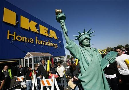 A woman dressed as the Statue of Liberty attends the grand opening of the Ikea home furnishing store in the borough on Brooklyn in New York, June 18, 2008. REUTERS/Shannon Stapleton