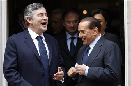 Britain's Prime Minister Gordon Brown (L) laughs with his Italian counterpart Silvio Berlusconi following their meeting in Downing Street in central London, September 10, 2008. REUTERS/Suzanne Plunkett