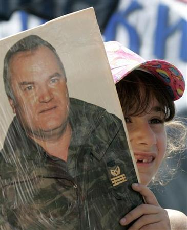 A girl holds a picture of Bosnian Serb war crimes fugitive Ratko Mladic during a rally in Belgrade May 26, 2007. REUTERS/Marko Djurica