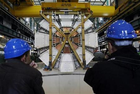 The last element, weighing 100 tonnes, of the ATLAS (A Toroidal LHC ApparatuS) experiment is lowered into the cave at the European Organization for Nuclear Research CERN (Centre Europeen de Recherche Nucleaire) in Meyrin, near Geneva February 29, 2008. REUTERS/Denis Balibouse