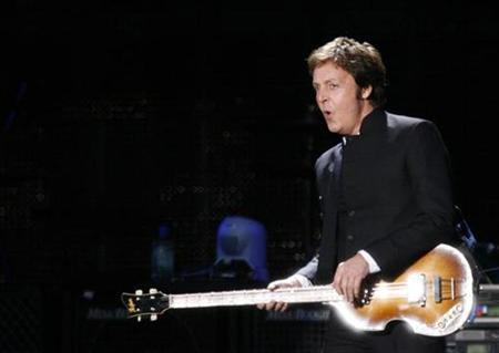 British musician Paul McCartney performs at the Liverpool Sound concert at Anfield stadium in Liverpool, northern England, June 1, 2008. REUTERS/Nigel Roddis