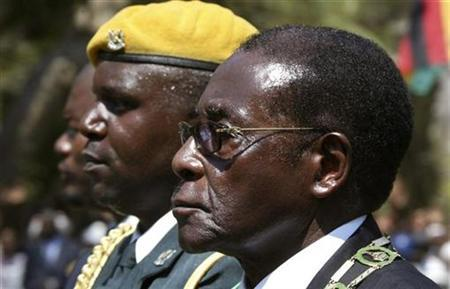 Zimbabwe'sPresident Robert Mugabe (R) arrives for the opening of the county's parliament in Harare, August 26, 2008. REUTERS/Philimon Bulawayo