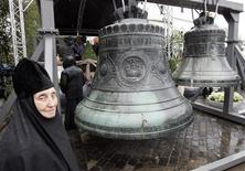 <p>A nun stands during a blessing ceremony for 18 bells in Danilovsky monastery in Moscow September 12, 2008. Eighteen original bells were returned by U.S. Harvard University in return for their copies. The original centuries-old bells were sold abroad by the Soviet government during Josef Stalin's rule. REUTERS/Alexander Natruskin</p>