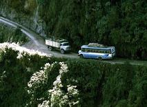 <p>A bus and a truck meet head-on in a near collision common to the North Yungas highway, a narrow, unpaved lane connecting La Paz to the Amazon Basin with a reputation as one of Bolivia's most dangerous rides, in this 1997 file photo. 	 REUTERS/Rickey Rogers</p>