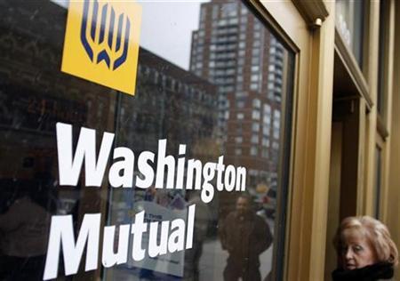 A woman walks into a Washington Mutual bank in New York, April 7, 2008. REUTERS/Joshua Lott