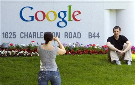A man has his picture taken in front of Google Inc. headquarters in Mountain View, California, May 8, 2008. REUTERS/Kimberly White