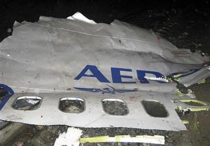 A piece of the fuselage of an Aeroflot airliner is seen at the site where it crashed outside the Ural city of Perm September 14, 2008. REUTERS/Alexei Zhuravlev/KP-Perm