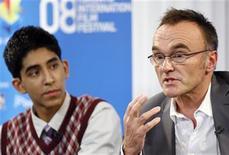 "<p>Director Danny Boyle (R) speaks beside actor Dev Patel during the ""Slumdog Millionaire"" news conference at the 33rd Toronto International Film Festival September 8, 2008. REUTERS/ Mike Cassese</p>"