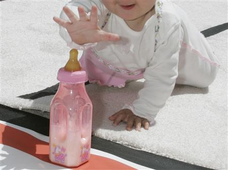 A nine-month old child reaches for a bottle as she nears the finish line in a ''diaper derby'' race at the premiere of ''Superbabies Baby Geniuses,'' at the Sony studios lot in Los Angeles, August 26, 2004. REUTERS/Fred Prouser