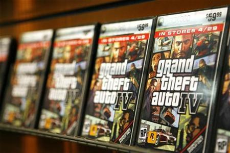 ''Grand Theft Auto IV'' video game boxes are displayed on a rack inside a GameStop store in New York prior to the midnight release of the video game April 28, 2008. REUTERS/Lucas Jackson