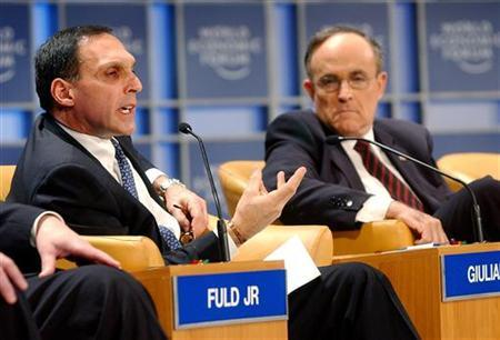 Former New York City Mayor Rudolf Giuliani (R) listens as Richard Fuld Jr., Chairman and CEO of Lehman Brothers, USA, speaks at the World Economic Forum in New York, February 1, 2002. REUTERS/Henny Ray Abrams/Pool