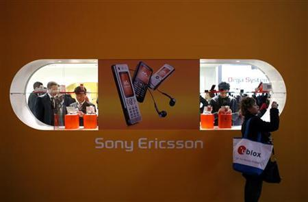 A visitor takes a picture in front of Sony-Ericsson's stand at the 3GSM World Congress in Barcelona February 15, 2007. REUTERS/Albert Gea