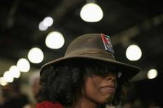 <p>A supporter of Democratic presidential candidate Senator Barack Obama (D-IL) attends a town hall meeting in Raleigh, North Carolina, August 19, 2008. REUTERS/Jim Young</p>
