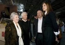 <p>Fashion designer Daria Zhukova (R), artists Ilya (2nd L) and Emilia (L) Kabakov, and curator Joseph Backstein attend the opening of the Garage art gallery in Moscow September 16, 2008. Fashion designer and ex-model Daria Zhukova opened a new art gallery in an avant garde Moscow bus shelter on Tuesday, attended by her Russian billionaire boyfriend Roman Abramovich. REUTERS/Sergei Karpukhin</p>