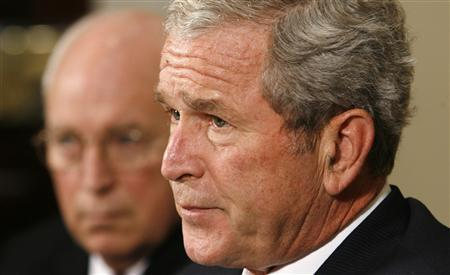 President George W. Bush speaks about Hurricane Ike as Vice President Dick Cheney listens at the White House in Washington September 15, 2008. REUTERS/Kevin Lamarque