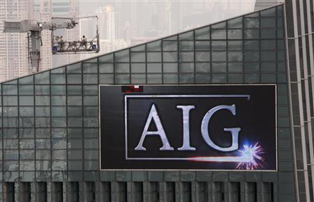 A screen at the top of AIG Tower in Hong Kong shows a footage of its company logo September 16, 2008. REUTERS/Bobby Yip