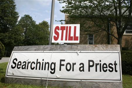 A sign seeking a Roman Catholic priest is pictured outside St. James Church in Wellesley, Massachusetts August 25, 2008. Facing dwindling shrinking congregations, shifting demographics and a drain on cash from settling sexual abuse lawsuits against priests, Roman Catholic churches are shuttering at a quickening pace in the U.S. Northeast. REUTERS/Jason Szep