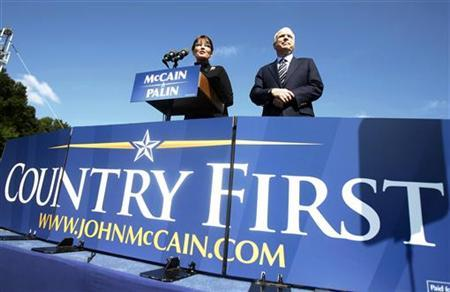 Republican presidential candidate Sen. John McCain (R-AZ) is introduced to speak by Republican vice presidential candidate Alaska Governor Sarah Palin (L) during an outdoor rally in Fairfax, Virginia, September 10, 2008. REUTERS/Jason Reed
