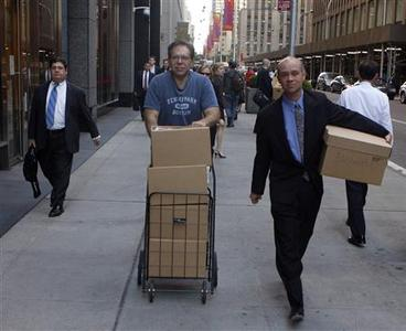 Two men walk out of the Lehman Brothers building with boxes in New York September 15, 2008. REUTERS/Joshua Lott