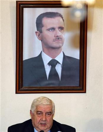 Syrian Foreign Minister Walid al-Moualem speaks under a portrait of President Bashar al-Assad at a news conference in Damascus January 2, 2008. REUTERS/Khaled al-Hariri