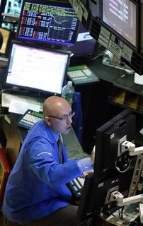 A trader for Bank of America works on the floor of the New York Stock Exchange, September 17, 2008. REUTERS/Brendan McDermid