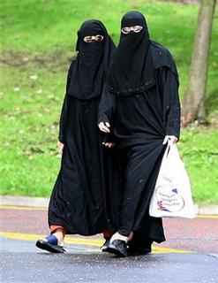Muslim women wearing veils walk in Labour MP Jack Straw's constituency of Blackburn, in this file photo from October 6, 2006. REUTERS/Neil Jones