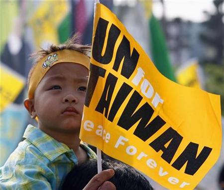 A child attends a rally titled ''U.N. for Taiwan'' in Taiwan's southern city of Kaohsiung, September 15, 2007. REUTERS/Nicky Loh