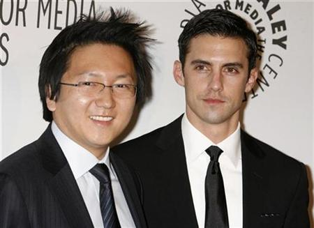 Actors Masi Oka (L) and Milo Ventimiglia, stars of the TV series ''Heroes'', pose as they arrive for the Paley Center for Media Los Angeles Gala honoring NBC's Jeff Zucker and Dick Ebersol in Los Angeles November 12, 2007. REUTERS/Fred Prouser