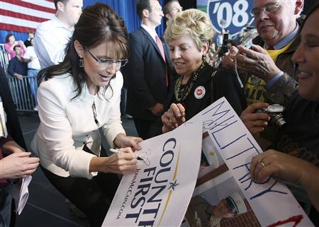 Republican vice presidential nominee Alaska Gov. Sarah Palin autographs a sign for a supporter after a campaign rally in Cedar Rapids, Iowa, September 18, 2008. REUTERS/Stephen Mally
