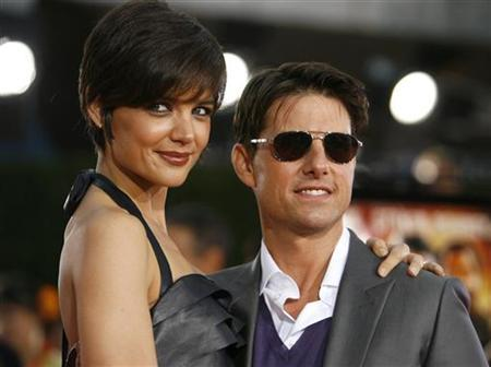 Tom Cruise and wife Katie Holmes at the premiere of ''Tropic Thunder'' at the Mann's Village theatre in Westwood, California, August 11, 2008. REUTERS/Mario Anzuoni