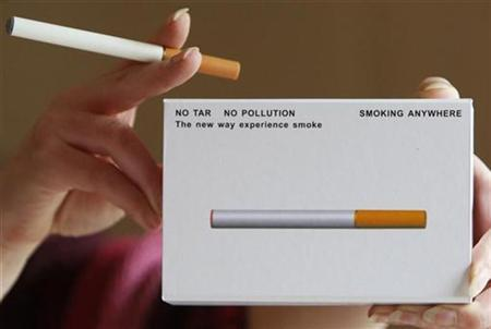 A woman displays a package of E-cigarette, an electronic substitute in the form of a rod, slightly longer than a normal cigarette, in Bordeaux, southwestern France, in this file photo from March 25, 2008. The changeable filter contains a liquid with nicotine and propylene glycol. When the user inhales as he would when smoking, air flow is detected by a sensor and a micro-processor activates an atomizer which injects tiny droplets of the liquid into the flowing air, producing a vapour. E cigarette is powered by a rechargeable battery. REUTERS/Regis Duvignau