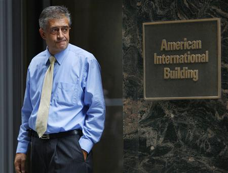 An employee exits the American International Group Inc Headquarters building in New York's financial district, September 16, 2008. REUTERS/Brendan McDermid