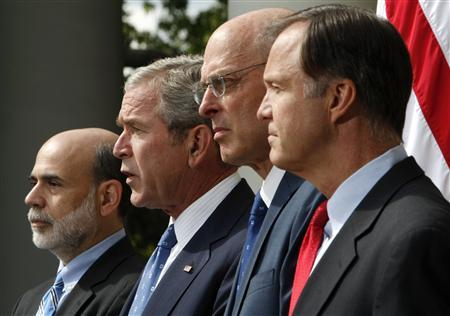 U.S. President George W. Bush (2nd L) makes remarks on the economy in the Rose Garden at the White House in Washington September 19, 2008. Bush is joined by Federal Reserve Chairman Ben Bernanke (L), Treasury Secretary Henry Paulson (2nd R), and SEC Chairman Christopher Cox. REUTERS/Jim Young