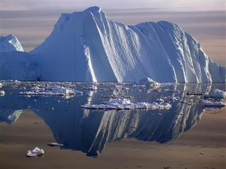 An iceberg carved from a glacier floats in the Jacobshavn fjord in south-west Greenland in this undated handout photograph released on September 20, 2006. REUTERS/Konrad Steffen/University of Colorado/Handout