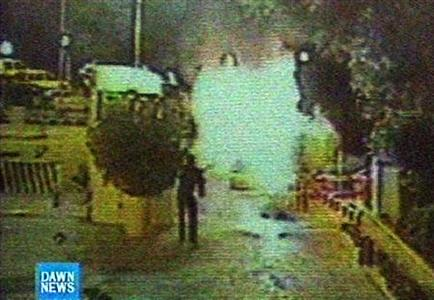 Video grab from security camera footage shows a guard attempting to put out a blaze in a truck before it blew up at the Marriott Hotel in Islamabad, September 20, 2008. REUTERS/Dawn TV via Reuters TV