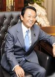<p>Newly appointed ruling Liberal Democratic Party (LDP) President Taro Aso sits on the chair of the president at the LDP headquarters in Tokyo September 22, 2008. REUTERS/Yoshikazu Tsuno/Pool</p>