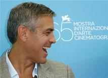 <p>Actor George Clooney laughs during a photocall in Venice, August 27, 2008. REUTERS/Denis Balibouse</p>
