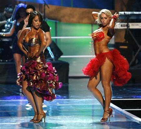 Cheryl Burke (L) and Kym Johnson from the television show ''Dancing with the Stars'' perform during the taping of the 2008 ''NCLR Alma'' awards at the Civic Auditorium in Pasadena, California, August 17, 2008. REUTERS/Mario Anzuoni