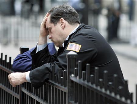 A trader stands outside the New York Stock Exchange September 29, 2008. REUTERS/Shannon Stapleton