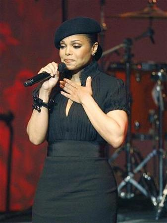 Singer Janet Jackson pauses as she introduces the Icon Award to her brothers, former members of Jackson Five, at the 8th annual BMI Urban Awards at the Wilshire theatre in Beverly Hills, California September 4, 2008. Jackson was rushed to a hospital with an unexplained illness minutes before a performance in Montreal on Monday night. REUTERS/Mario Anzuoni