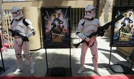 Star Wars characters Storm Troopers pose with posters from the new animated film ''Star Wars The Clone Wars'' at the film's premiere in Hollywood, California, August 10, 2008. REUTERS/Fred Prouser