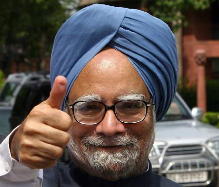 India's Prime Minister Manmohan Singh gestures to photographers upon his arrival at the Indian parliament in New Delhi in this July 22, 2008 file photo. The U.S. Congress has approved a landmark deal ending a three-decade ban on U.S. nuclear trade with India, unleashing billions of dollars of investment. REUTERS/B Mathur