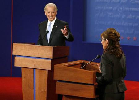 Democratic vice presidential nominee Senator Joe Biden gestures towards Republican vice presidential nominee Alaska Governor Sarah Palin during the vice presidential debate at Washington University in St. Louis, Missouri October 2, 2008. REUTERS/Rick Wilking/Pool
