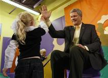 <p>Prime Minister Stephen Harper receives a high-five during a campaign stop at a day-care in Ottawa October 6, 2008. REUTERS/Chris Wattie</p>