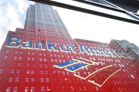 A building is reflected in the window of a Bank Of America branch in New York, October 6, 2008. REUTERS/Lucas Jackson