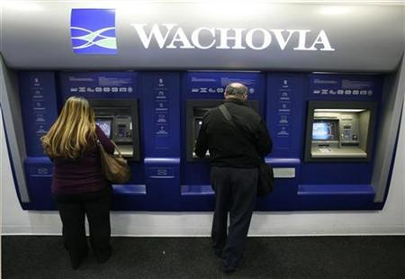Customers withdraw money from ATMs inside a Wachovia branch in New York, October 6, 2008. REUTERS/Lucas Jackson