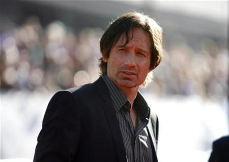 Cast member David Duchovny attends the movie premiere of ''The X-Files: I Want to Believe'' at the Grauman's Chinese theatre in Hollywood, California July 23, 2008. REUTERS/Mario Anzuoni