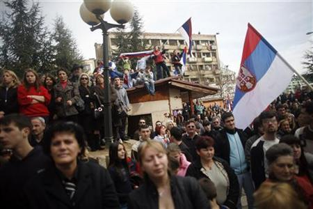 Serb protesters hold flags as they gather for a protest in the ethnically divided town of Mitrovica in Kosovo February 23, 2008. REUTERS/Damir Sagolj